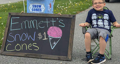 The boy opened his business in order to earn a bike