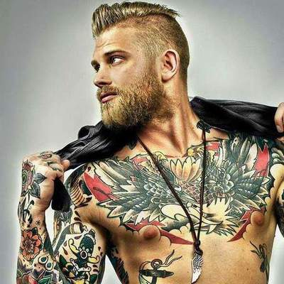 Men's tattoo on his chest, and their features