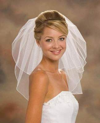 Wedding hairstyle for medium hair with a veil with their hands (photo)